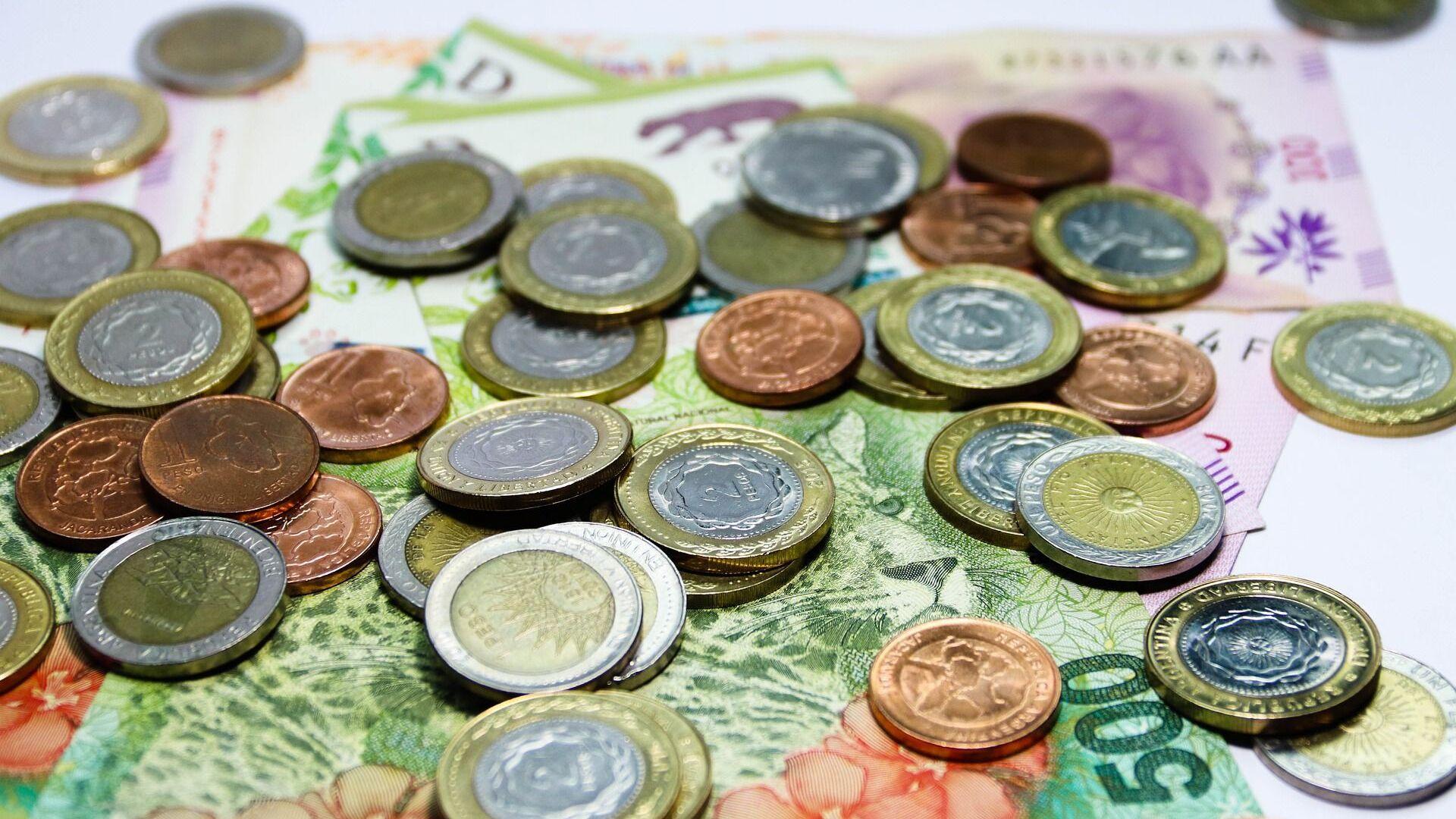 Pesos argentinos (imagen referencial) - Sputnik Mundo, 1920, 13.05.2021
