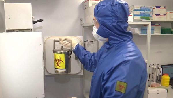 Un laboratorio  - Sputnik Mundo