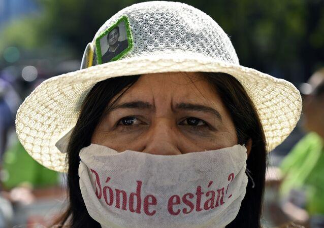 Una mujer en una protesta contra las desapariciones en México