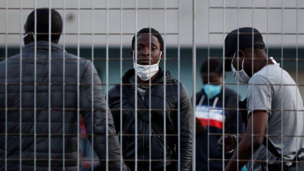 Migrantes en Italia - Sputnik Mundo