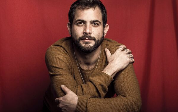 Jesús Mayorga es el fotógrafo y videógrafo del equipo - Sputnik Mundo