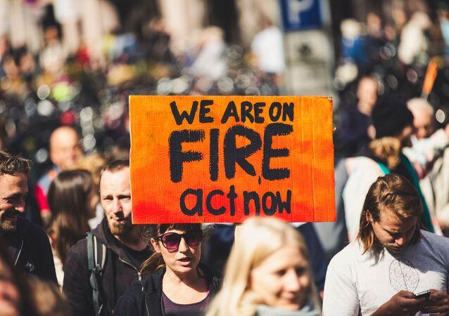 Cartel de manifestación por cambio climático