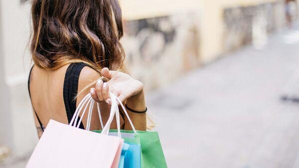 Mujer de compras - Sputnik Mundo