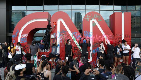 Logo de CNN en Anlanta, EEUU - Sputnik Mundo