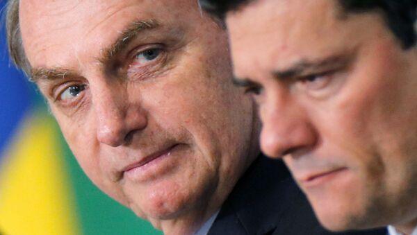 El presidene de Brasil, Jair Bolsonaro, y el exministro Sérgio Moro  - Sputnik Mundo