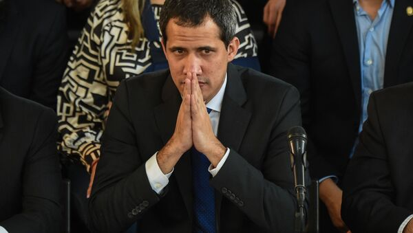 El líder de la oposición Juan Guaidó en un acto en Caracas - Sputnik Mundo