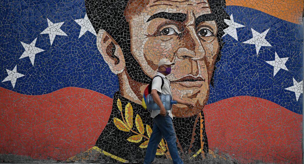 Una imagen de Simón Bolívar junto con la bandera venezolana