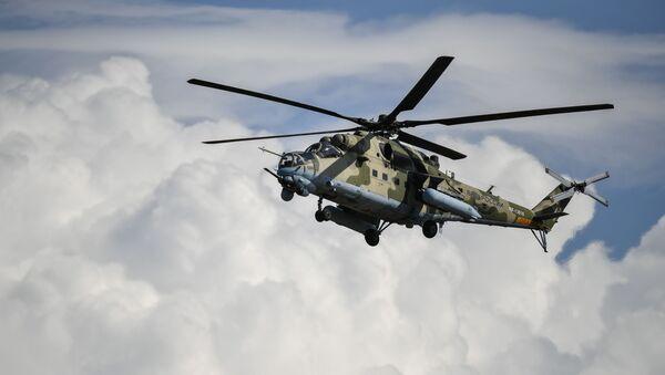 Un helicóptero Mi-24 (archivo) - Sputnik Mundo