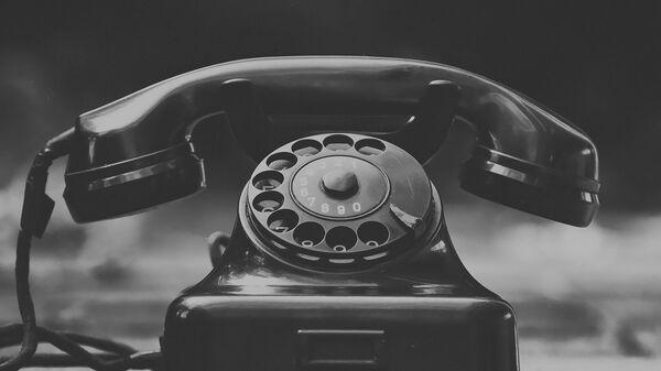 Un teléfono (imagen referencial) - Sputnik Mundo