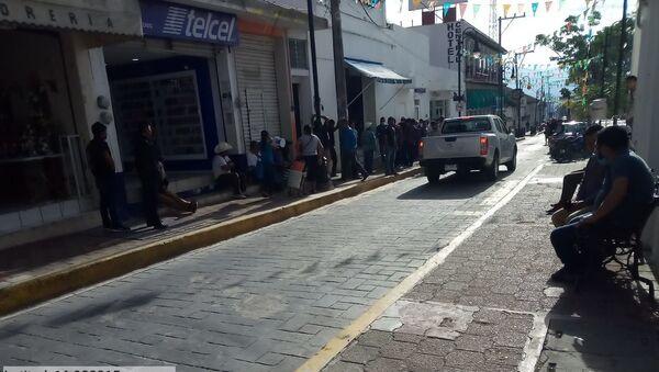 Pago de sembradores del programa Sembrando Vida en la capital municipal de Ocosingo (Chiapas),  el 8 de junio de 2020 - Sputnik Mundo