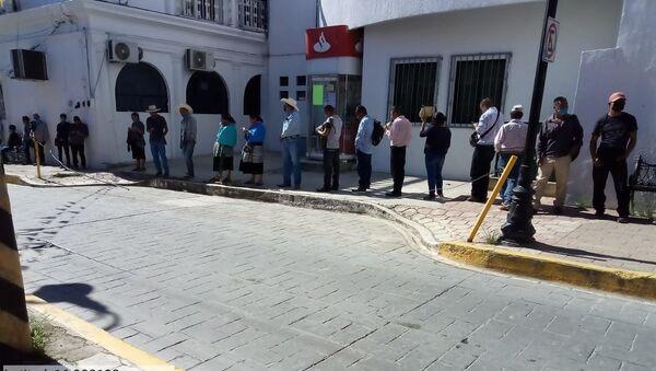 Pago de sembradores del programa Sembrando Vida en la capital municipal de Ocosingo (Chiapas),  el 9 de junio de 2020 - Sputnik Mundo