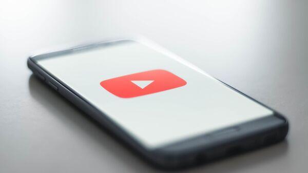 Logo de YouTube - Sputnik Mundo