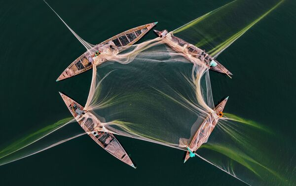 'Pesca en Jamuna' por Abdul Momin, Bangladés - Sputnik Mundo