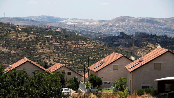 Un asentamiento israelí en la Cisjordania ocupada - Sputnik Mundo