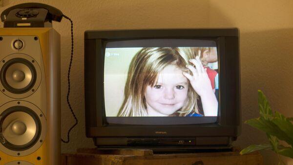 Imagen de Madeleine McCann en un televisor - Sputnik Mundo