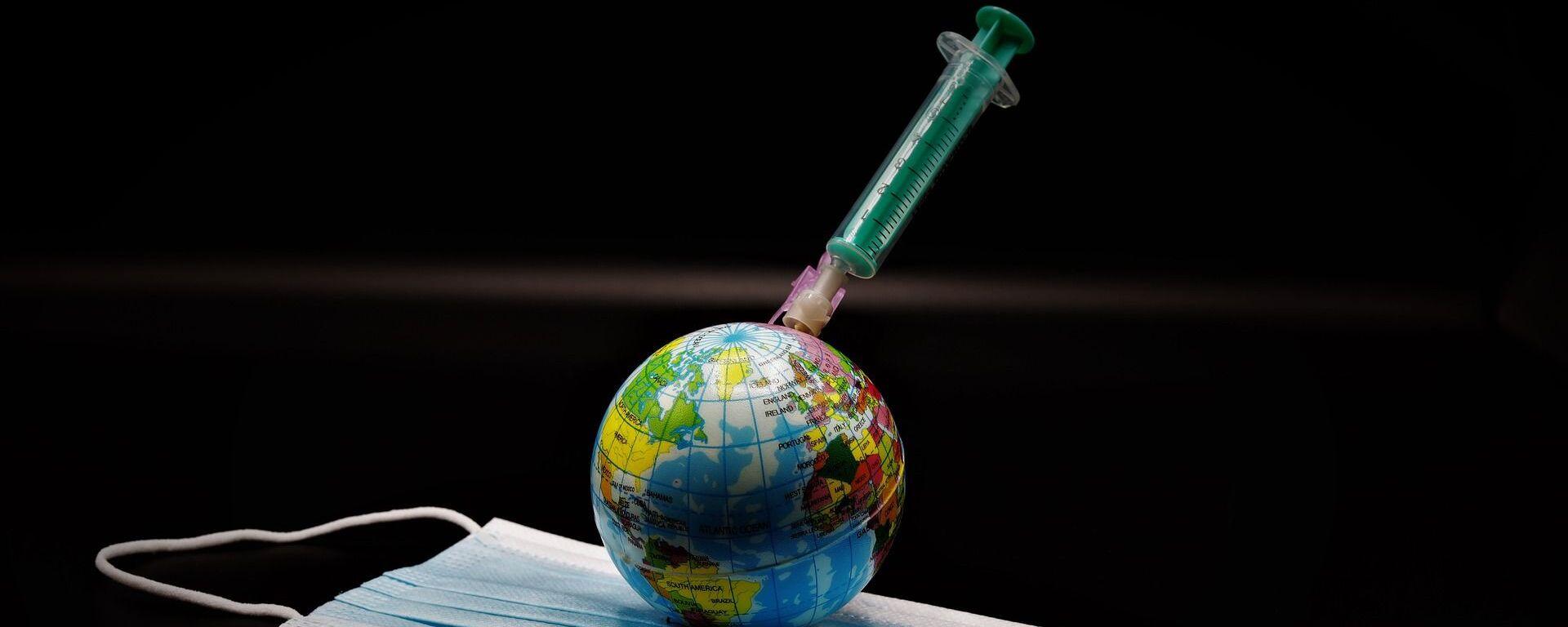 Un globo, una vacuna y una mascarilla durante el brote de coronavirus en el mundo - Sputnik Mundo, 1920, 10.03.2021