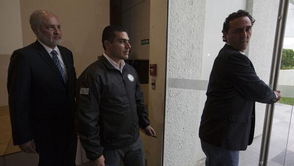 El secretario de Seguridad y Protección Ciudadana de la Ciudad de México, Omar García Harfuch (en el centro) - Sputnik Mundo