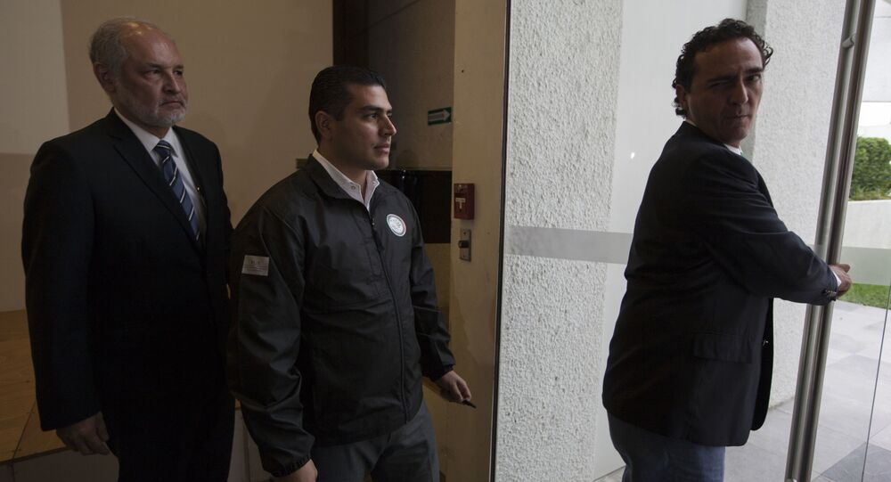 El secretario de Seguridad y Protección Ciudadana de la Ciudad de México, Omar García Harfuch (en el centro)