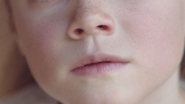 La cara de una niña - Sputnik Mundo