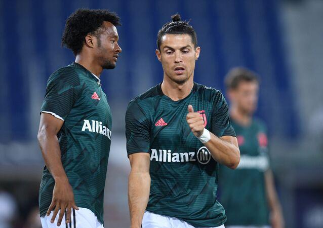 Futbolistas de la Juventus, Cristiano Ronaldo (derecha) y Juan Cuadrado (izquierda)