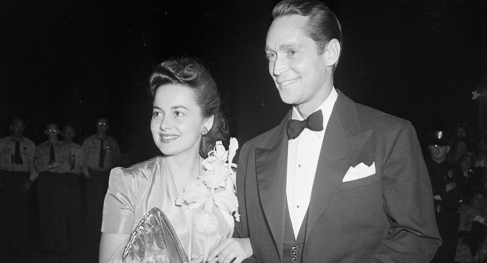 La actirz Olivia de Havilland junto al actor Franchot Tone