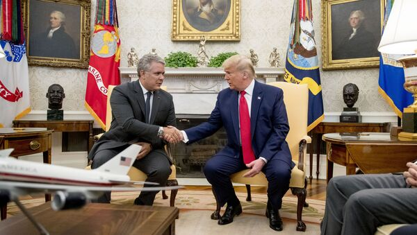 Donald Trump e Iván Duque reunidos en la Casa Blanca. Washington, 2 de marzo de 2020 - Sputnik Mundo