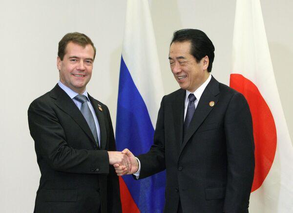 El presidente de Rusia, Dmitri Medvédev, y el primer ministro de Japón, Naoto Kan. - Sputnik Mundo