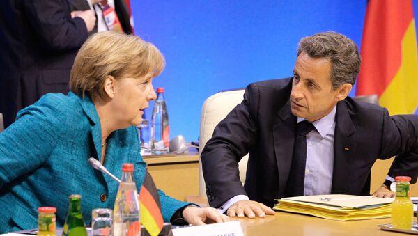 Canciller de Alemania, Angela Merkel, y ex presidente de Francia, Nicolas Sarkozy - Sputnik Mundo