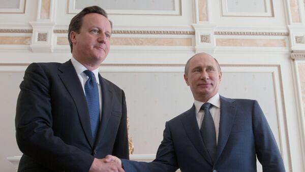 Primer ministro del Reino Unido, David Cameron, y presidente de Rusia, Vladímir Putin - Sputnik Mundo