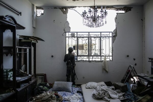 Combates entre el Ejército y los islamistas en las afueras de Damasco - Sputnik Mundo