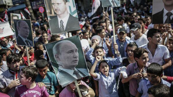 Митинг в поддержку Б. Асада и В. Путина в Сирии - Sputnik Mundo