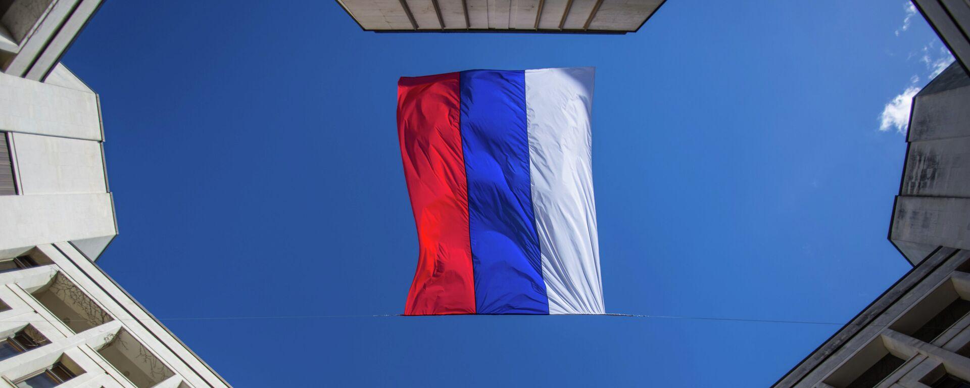 La bandera de Rusia sobre la sede del Consejo Supremo de Crimea - Sputnik Mundo, 1920, 16.03.2021