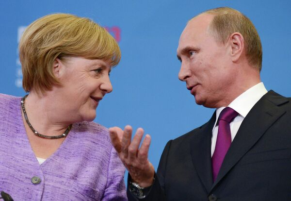 Putin y Merkel se reunirán en Normandía - Sputnik Mundo