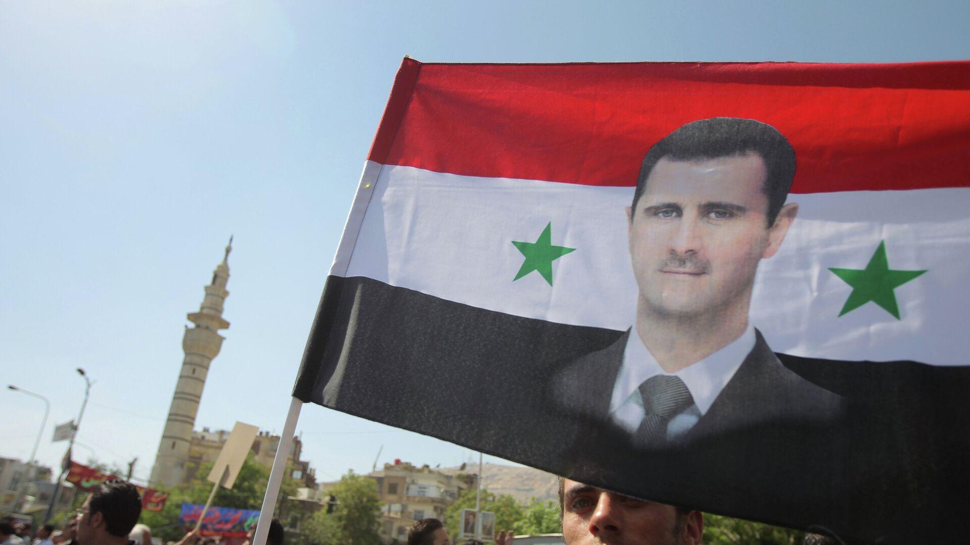 Митинг в поддержку Башара Асада в Дамаске - Sputnik Mundo, 1920, 01.04.2021