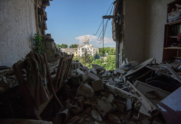 Kiev bombardea ciudades abandonadas por milicianos para presionar a los descontentos - Sputnik Mundo