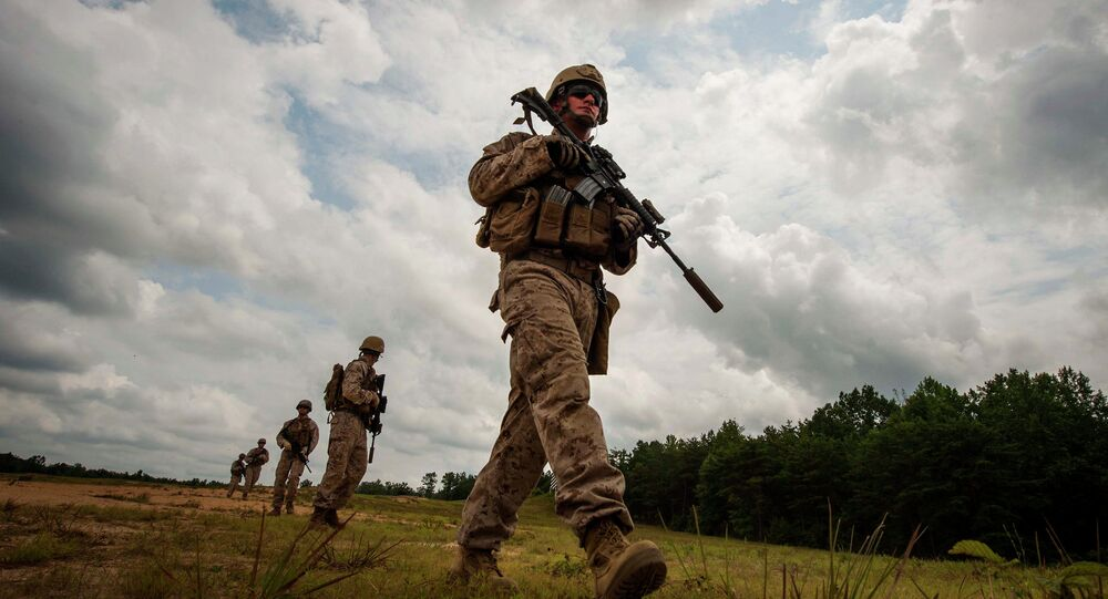 U.S. Marines assigned to Echo Company 4th Reconnaissance Battalion conduct a patrol during a live fire exercise at Camp Upshur, Marine Corps Base Quantico on July 21, 2014