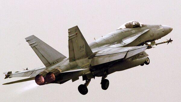 Un caza F/A-18, foto archivo - Sputnik Mundo