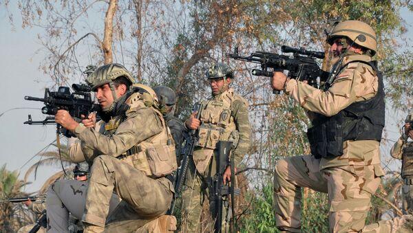 Militantes iraquíes - Sputnik Mundo