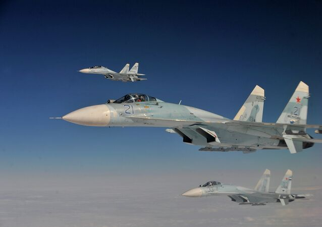 Russian Federation Air Force Su-27 aircraft intercept a simulated hijacked aircraft entering Russian airspace Aug. 27, 2013