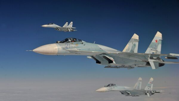 Russian Federation Air Force Su-27 aircraft intercept a simulated hijacked aircraft entering Russian airspace Aug. 27, 2013 - Sputnik Mundo