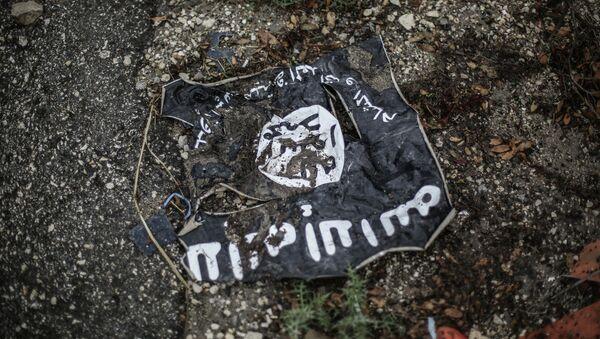 Bandera del grupo terrorista Estado Islámico (EI) - Sputnik Mundo