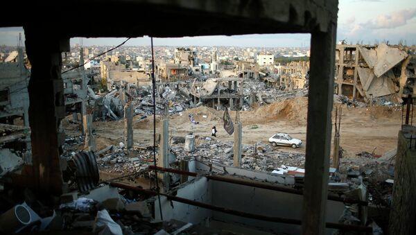 Ruinas de las casas en el este de la ciudad de Gaza, 01 de diciembre 2014 - Sputnik Mundo
